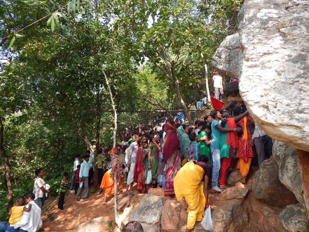 Devotees waiting for their turn to see the holy forest goddess